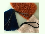 and rust colored shearling pouches!